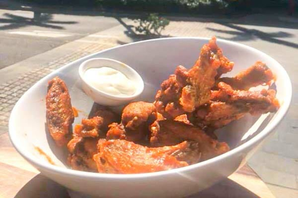 chicken wings in buffalo sauce, served by KC's Bar & Grill, Main Street Airlie Beach, Whitsunday Region