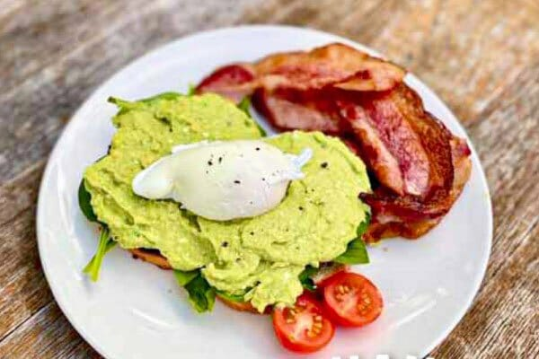 Smashed Avocado with bacon and eggs served at The Hangar Cafe & Bar, Flametree, Whitsundays, Australia