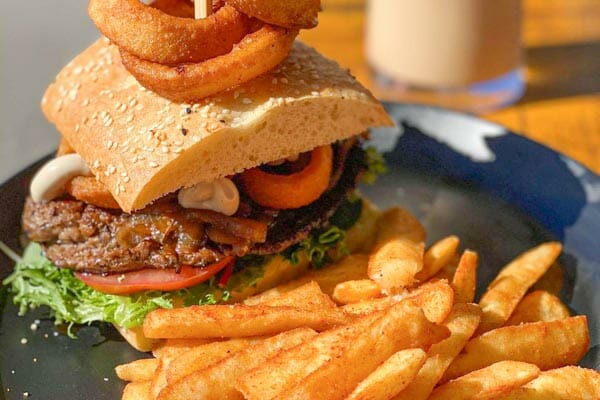 kingsford smith steak sandwich and fries served at The Hangar Cafe & Bar, Flametree, Whitsundays, Australia