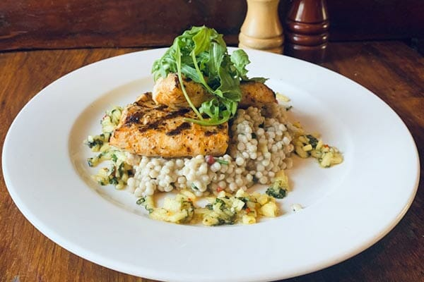 crocodile, pomegranate and couscous dish , served by KC's Bar & Grill, Main Street Airlie Beach, Whitsunday Region