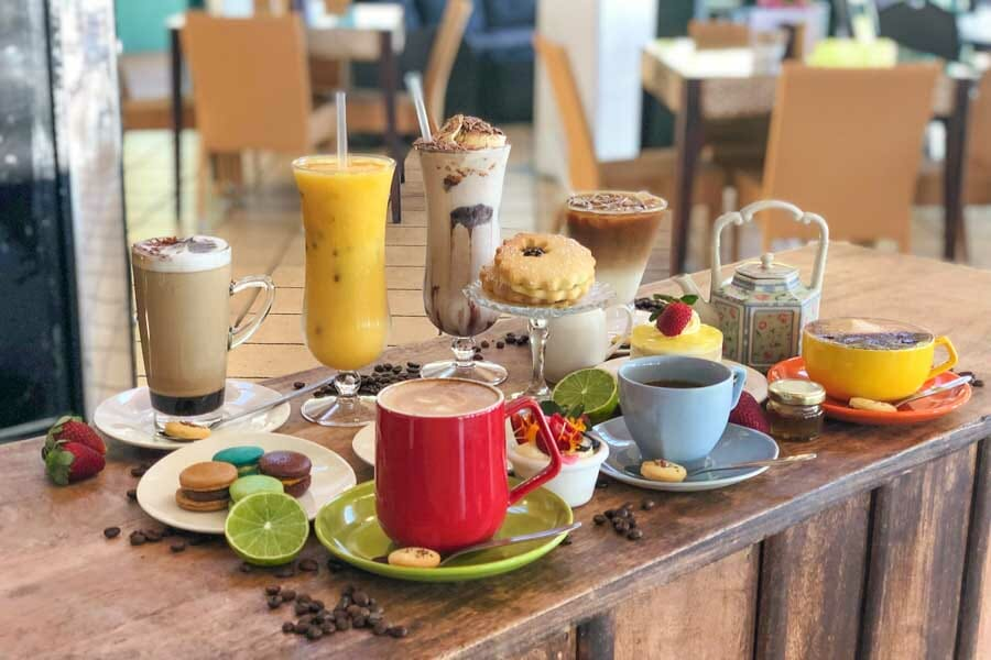 Coffee, Juice, iced chocolates and biscuits on a table at My Rainbow Bakery & Cafe, Cannonvale, Whitsunday Regions