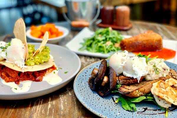 3 plates of breakfast dishes at Airlie Beach Treehouse, Whitsundays