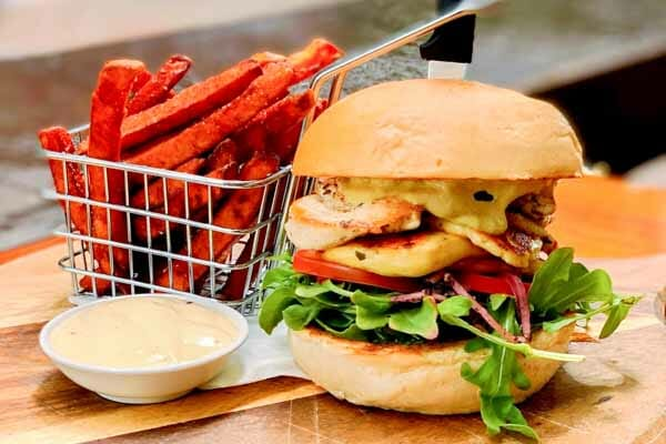 grilled chicken and haloumi burger served with sweet potato fries at Airlie Beach Treehouse, Whitsundays