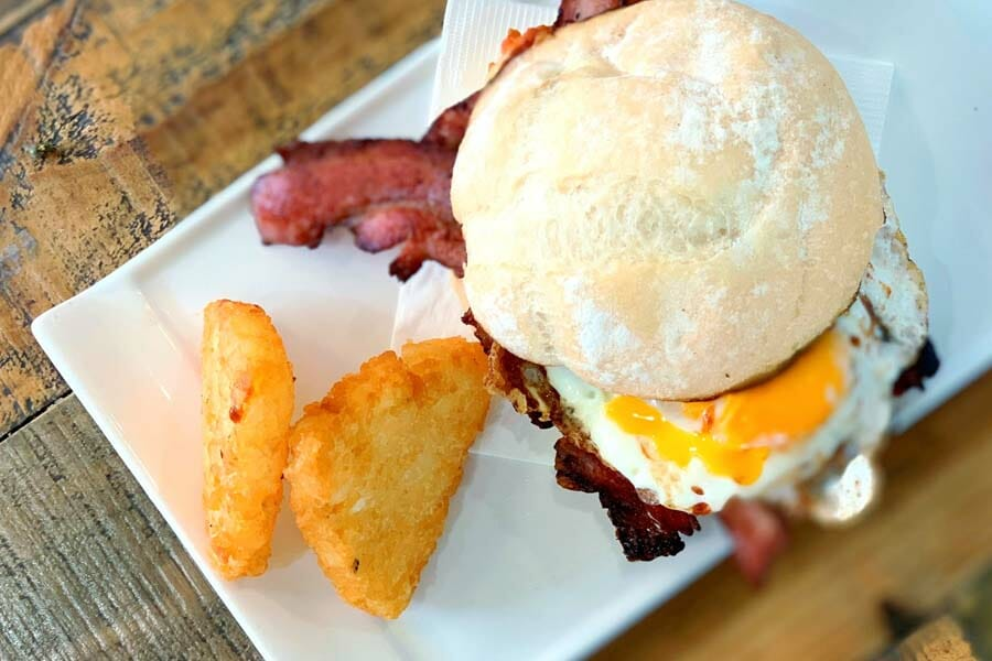 bacon and egg roll served at Airlie Beach Treehouse, Whitsundays