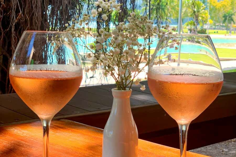 2 glasses of rose wine served at Airlie Beach Treehouse, Whitsundays