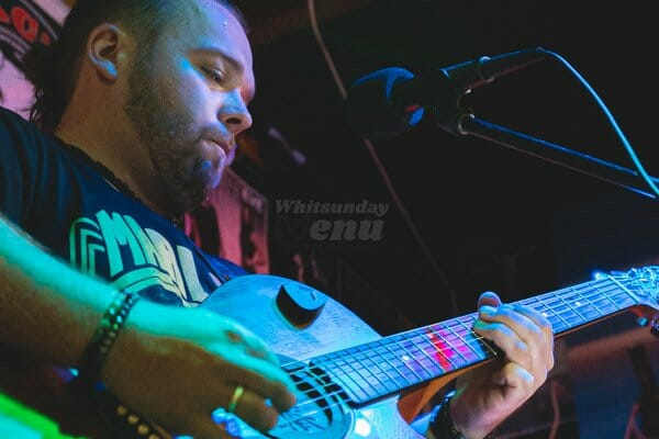 ash smith on guitar playing live music at KC's Bar & Grill, Main Street Airlie Beach, Whitsunday Region