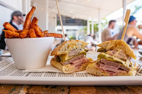 Cuban Sandwich with sweet potato fries in the restaurant at Anchor Bar