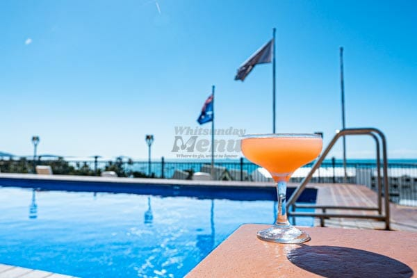 Lychee Martini next to the pool with a sea view at Anchor Bar, Whitsunday Region
