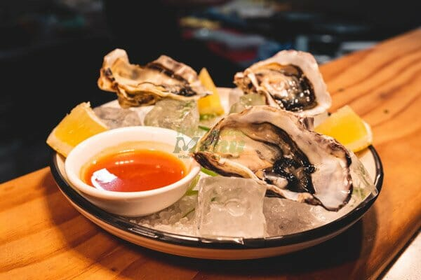 Natural Oysters on the bar at night at Breeze Bar, Airlie Beach, Whitsunday Region