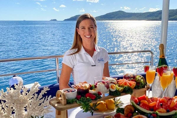 spread of food and hostess aboard Alani super yacht, by D'vine Catering & Events, Whitsundays, Queensland, Australia