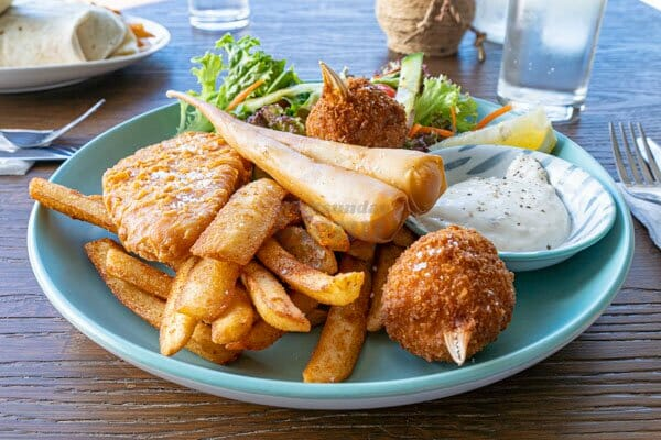neptunes plate served with crab, fish, fries and seafood served at The Hangar Cafe & Bar, Flametree, Whitsundays, Australia