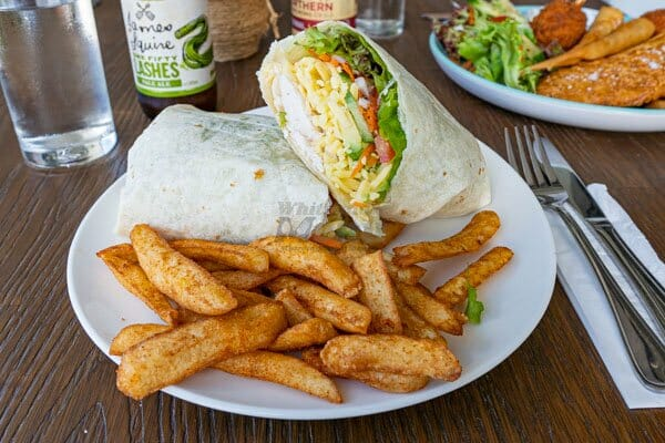 Chicken Wrap and fries at The Hangar Cafe & Bar, Flametree, Whitsundays, Australia