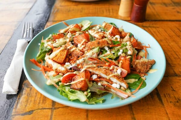 roast pumpkin crispy chicken salad served at The Hangar Cafe & Bar, Flametree, Whitsundays, Australia