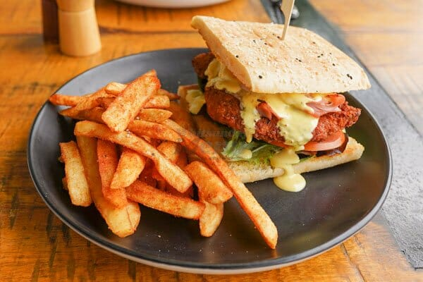 Mile High Cordon Bleu with fries served at The Hangar Cafe & Bar, Flametree, Whitsundays, Australia