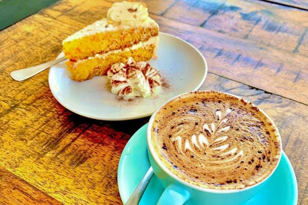 carrot cake and cappuccino served at The Hangar Cafe & Bar, Flametree, Whitsundays, Australia