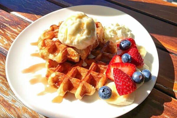 wirraway waffles, berries and icecream served at The Hangar Cafe & Bar, Flametree, Whitsundays, Australia