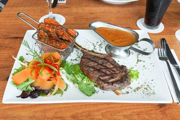 400gram Prime Rib On The Bone, served with sweet potato fries from Jubilee Tavern, jubilee pocket, Whitsundays