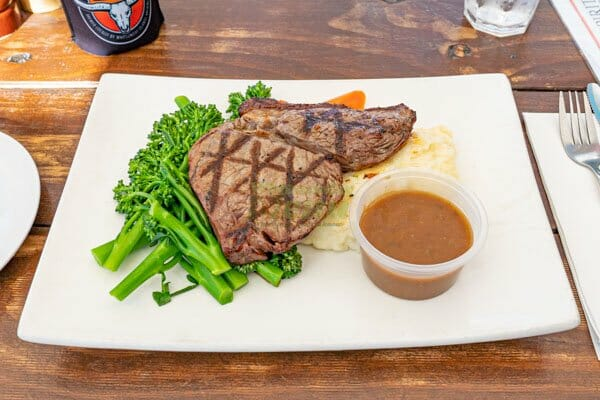 200 gram Sirloin with vegetables and mashed potato, served by KC's Bar & Grill, Main Street Airlie Beach, Whitsunday Region