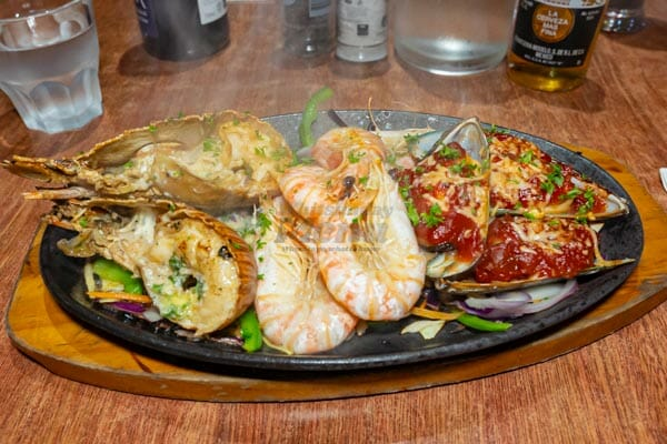 seafood sizzling hot plate with moreton bay bugs, oysters and prawns, Mika, Airlie Beach, Whitsunday Islands, Queensland, Australia