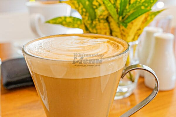 Latte on a table at The Deck, Main Street Airlie Beach, Whitsunday Region, Queensland