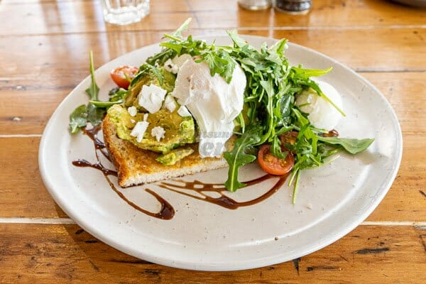 smashed avocado, poached egg at Fat Frog Beach Cafe, Cannonvale, Whitsundays