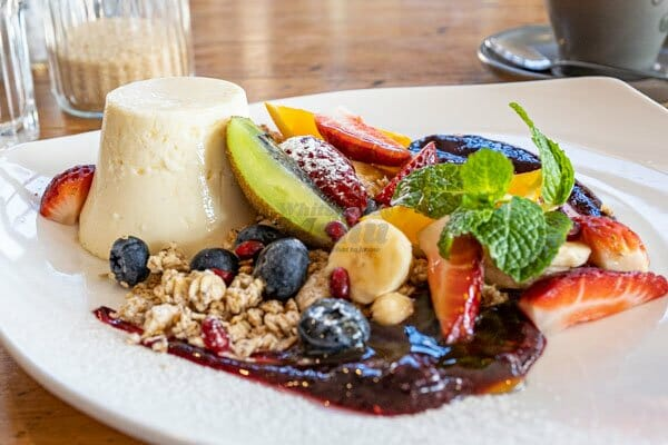 Breakfast panna cotta, granola, fresh fruit salad and mint at Fat Frog Beach Cafe, Cannonvale, Whitsundays