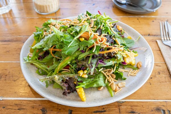Thai Salad on a table inside at Fat Frog Beach Cafe, Cannonvale, Whitsundays