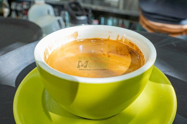 Long black served in a mug at Airlie Beach Treehouse, Whitsundays