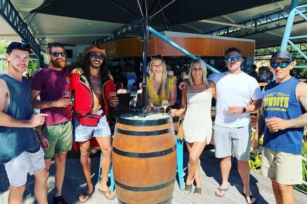 group of people outside coral sea resort, Via Paradise, Airlie Beach, Beach Bar Hopper Tour, Whitsundays, Queensland, Australia