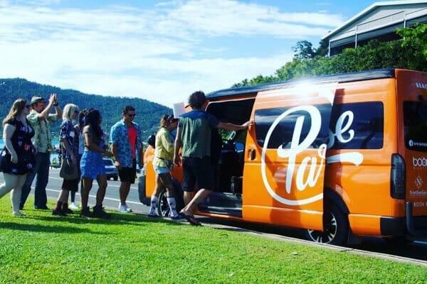 people getting in a van, Via Paradise, Airlie Beach, Beach Bar Hopper Tour, Whitsundays, Queensland, Australia
