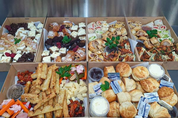 boxes of pastries, pies and wraps ready for delivery by 22 buttercup lane