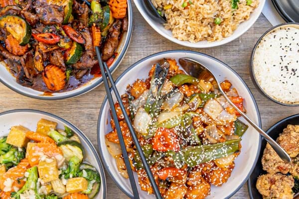 asian fusion dishes on a table with chopsticks at cool la la