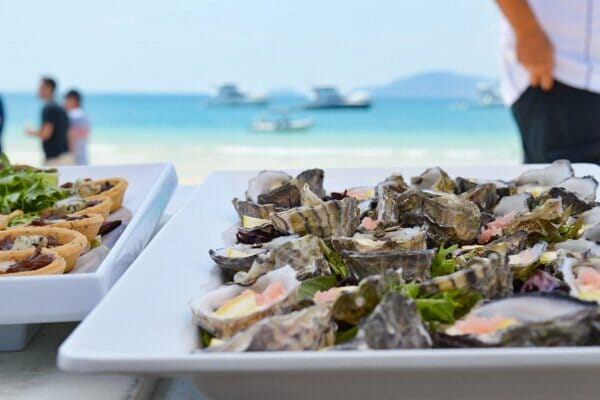 tray of oysters on a table at Whitehaven beach prepared by D'vine catering