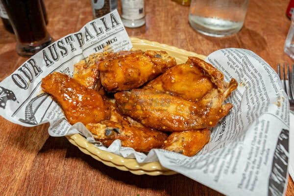 Sticky chicken wings, by Mika Restaurant BBQ Bar, Airlie Beach,