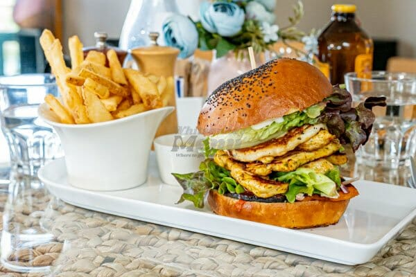 Moroccan Chicken Burger with fries serves at My Rainbow Bakery & Cafe, Cannonvale, Whitsunday Regions
