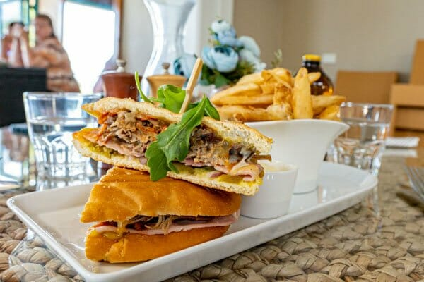 Spicy Cuban Grilled Panini with fries serves at My Rainbow Bakery & Cafe, Cannonvale, Whitsunday Regions
