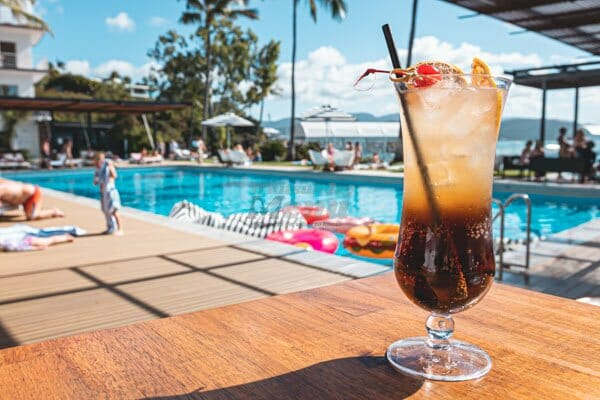 long island iced tea cocktail by the pool at The Rocks, restaurant bar in Airlie Beach, Whitsundays