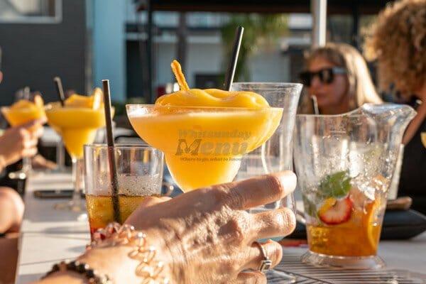 mango daiquiri and other drinks on a table at coral sea resort, Airlie Beach, Beach Bar Hopper Tour, Whitsundays, Queensland, Australia
